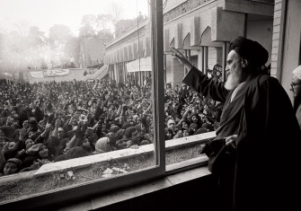 Ayatollah Khomeini greets the crowd at Tehran University after his return from exile in 1979.