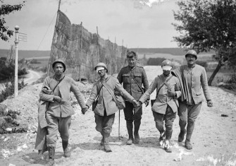Holding the line: French soldiers blinded by gassing at the Marne, 1918.