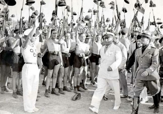 Benito Mussolini and Fascist Blackshirt youth in 1935.