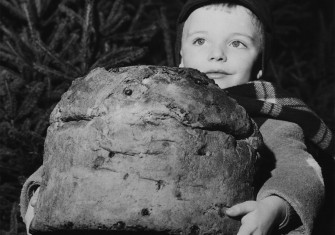 A child carrying a panettone in Milan, 20 December 1958.