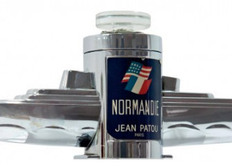A chrome bottle of perfume in the shape of SS Normandie housed a scent created by Jean Patou, 1935.