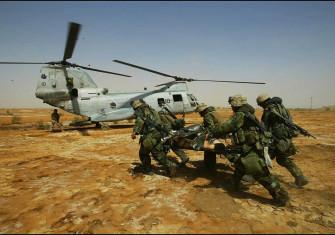 US Marines evacuating wounded comrades, Kut al-Amara, 3 April 2003. (Gilles Bassignac/Gamma-Rapho, Paris)