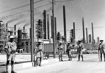 Iranian riflemen guard a refinery belonging to the Anglo-Iranian Oil Company, 1940s.