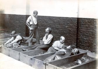 Men in 'coffin beds'.