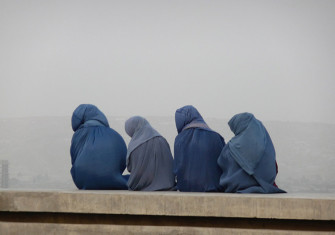 Young women gazing at Kabul from its hills, c.2014.