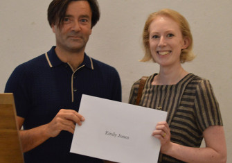 Emily Jones receives her prize from editor Paul Lay.