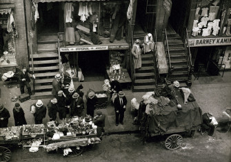 Hester Street's pushcarts, by Berenice Abbot, 1935.