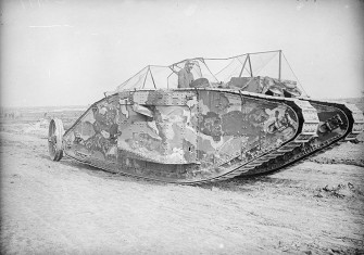 The first official photograph of a British tank in action, Flers-Courcelette, September 15th, 1916
