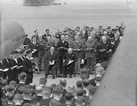 President Roosevelt and Prime Minister Churchill attend a Sunday service on the quarterdeck of HMS Prince of Wales during the Atlantic conference,  10 August 1941.