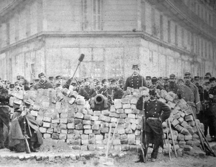 A barricade on Rue Voltaire, after its capture by the regular army during the Bloody Week