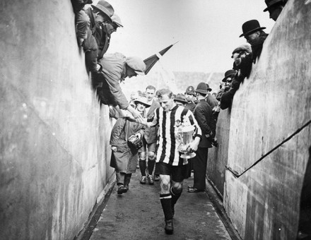 Frank Hudspeth carries the FA Cup after Newcastle United's win against Aston Villa in 1924. Topical Press Agency / Getty Images