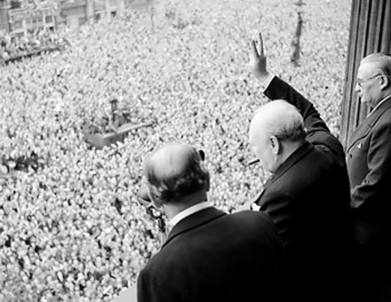 Winston Churchill waves to crowds in Whitehall, May 8th, 1945.