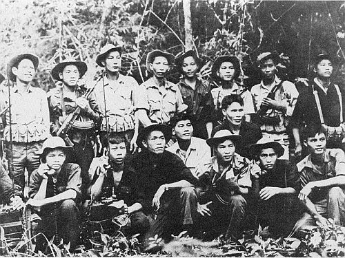 Viet Cong troops pose with new AK-47 assault rifles and American field radios
