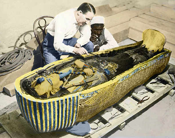 Rash intruders? Howard Carter and an Egyptian assistant examine the sarcophagus of Tutankhamun. Bridgeman/Leemage