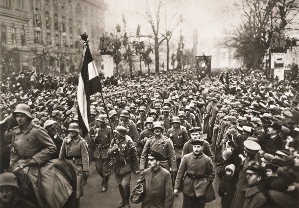 Crowds line the streets of Berlin as German soldiers return, hailed as 'undefeated', at the end of the war, 1918