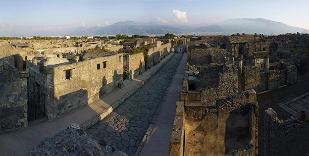 Staying put: Pompeii today, with the looming presence of Vesuvius in the background. British Museum