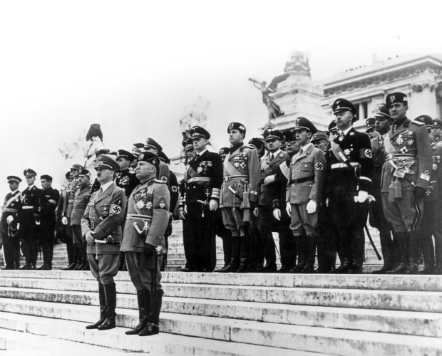 Mussolini and Hitler with Nazi and Fascist officials on the steps of the Vittoriano in May 1938. The Fascist leader used the monument to reinforce his status as national leader