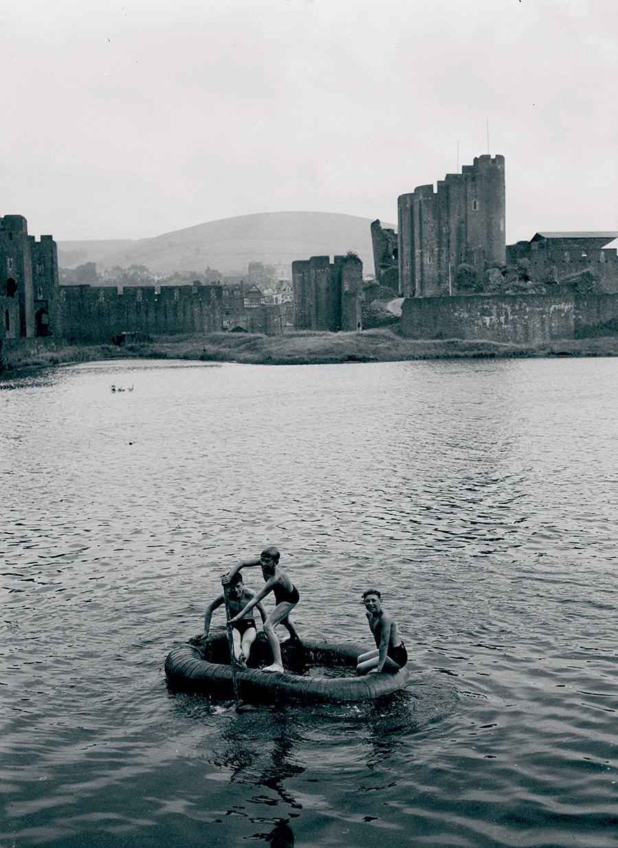 Caerphilly boys rowing on the castle moat, photograph by Geoff Charles, 1951.